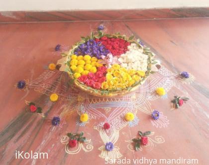 Rangoli: Urli flower decoration