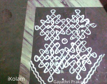 Rangoli: Navami kolam for Navarathri with wet maavu