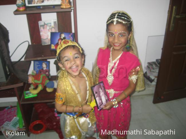 Krishna & Radha - This is gokulastami celebration.Viswesh ,Nithila are with their dad s photo (his krishna costume)