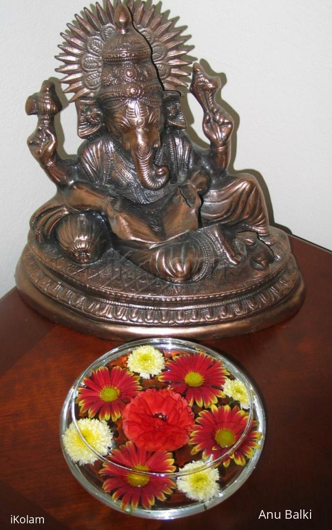 Rangoli: Flowers in glass bowl