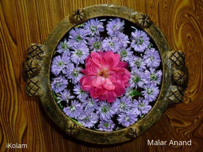 Rangoli: Flowers in a Urli