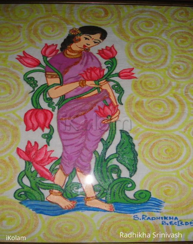 Rangoli: lady painting frame work
