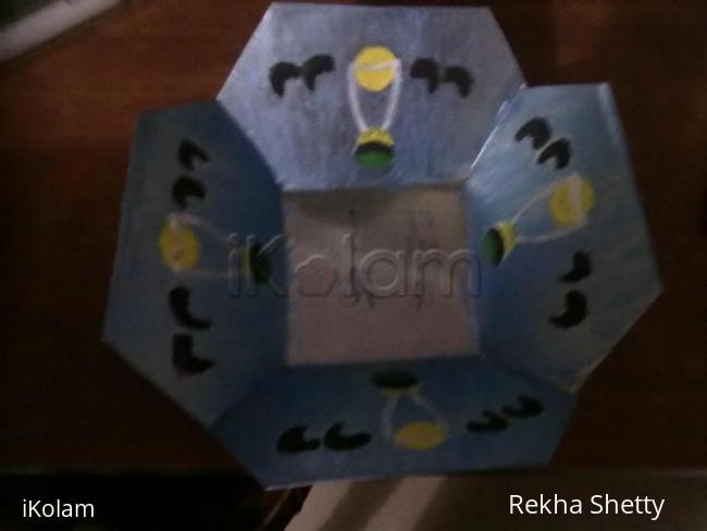 Rangoli: metal basket painting