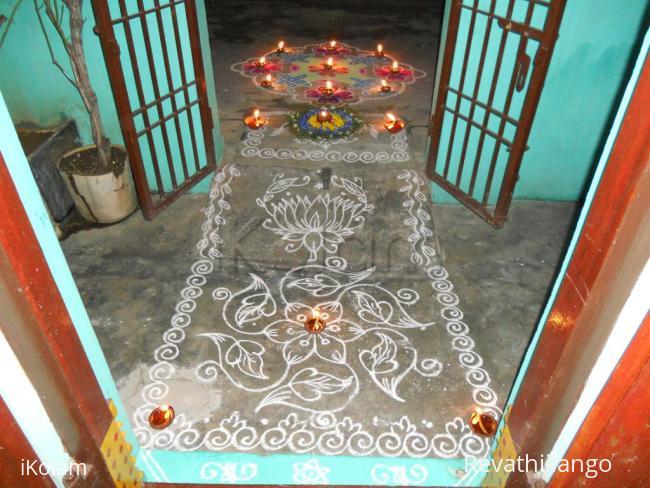 Rangoli: On karthigai, simple kolam with borders, poo decoration & kolam with deepam.