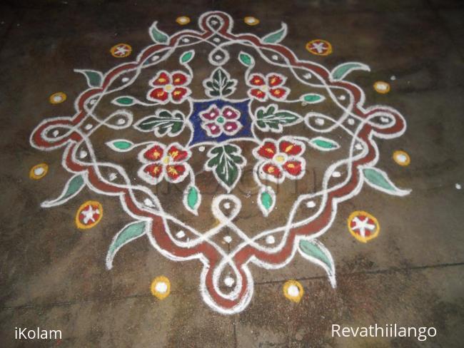 Rangoli: Chikku kolam with flowers & leaves.