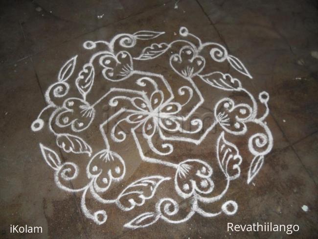 Rangoli: Daily kolam in white.