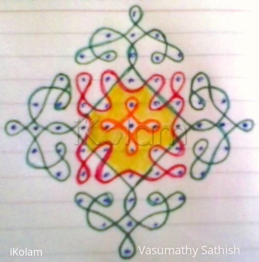 Rangoli: Chikku kolam with 11-1 straight dots.