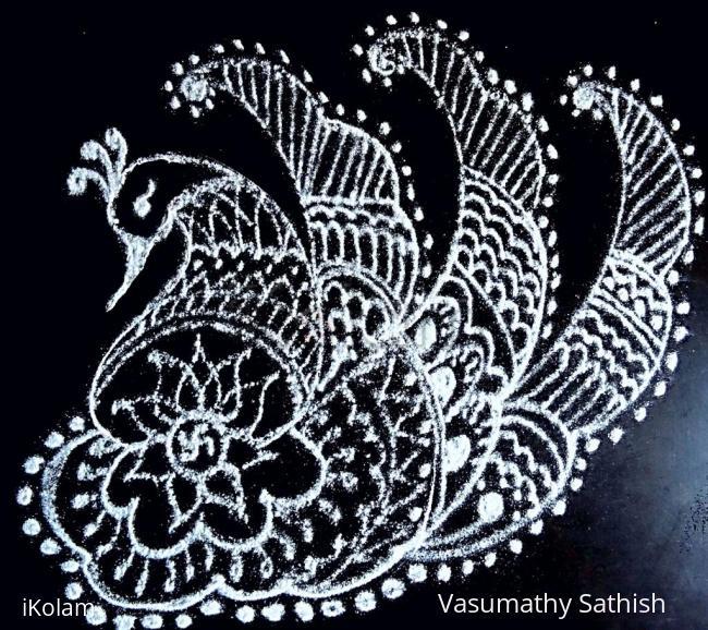 Rangoli: Freehand peacock rangoli with lotus and small swastik