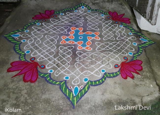 Rangoli: chikku kolam with colourful border.