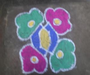 dotted kolam cloured  6 dots 6 lines.