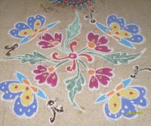 Rangoli: Butterflies on flowers.