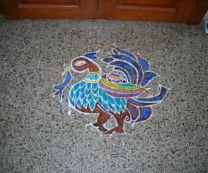 Dotted peacock rangoli
