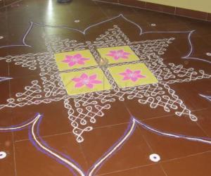 Dotted Rangoli - The line goes like creeper and shapes out like a star