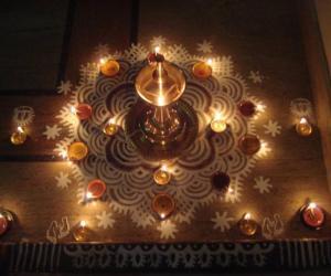 Karthigai kolam with lamps
