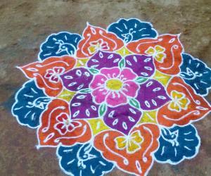 Rangoli: Free hand flower and peacock design