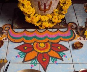 Rangoli: kolam in front of tulsi