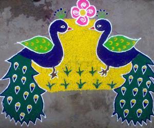 "Rangoli: TWIN PEACOCKS SAYING ""HAPPY NEW YEAR"""