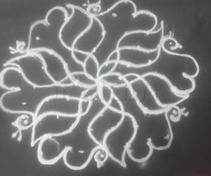 Rangoli: 9 to 5 kolam flower with peacock