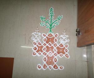Rangoli: small tulasi brindavan in chikku