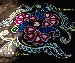 Rangoli: Rev's flower peacock kolam.