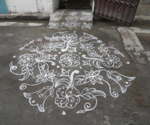 Different Flower Kolam in White.