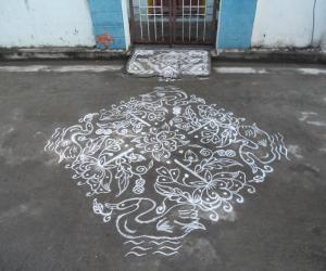 Rangoli: Swan & Rose Kolam in White.