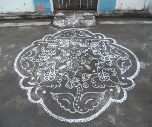 Rangoli: Flying swans & flowers. Kolam in white.