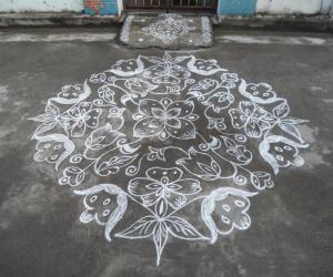 Rangoli: kolam in white. Flowers & leaves.