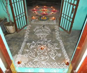 On karthigai, simple kolam with borders, poo decoration & kolam with deepam.