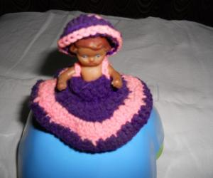 A simple doll, covered with crochet skirt & cap.