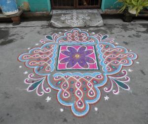 Rangoli: Chikku kolam & flower differently.