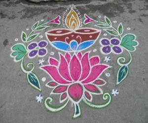 Deepam on lotus kolam.