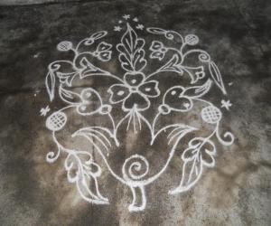 Rangoli: Kolam in white flower bunch.