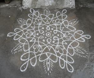 Rangoli: Aadi velli  star chikku cum deepam kolam. Newly created.