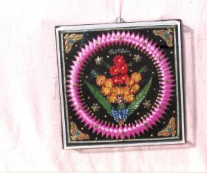 Craft made by me with cooker gascut, match sticks, tape wire & flowers.
