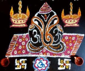 Rangoli: Simple Ganesha kolam with rice flour, haldi, Kumkum.