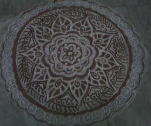 Free hand kolam with rice flour and kavi for margazhi