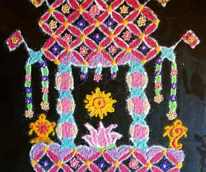 Ratha Saptami kolam in Dotted Pattern .  Dot Count from bottom 11×1;9×1;11×2;7×6;11×2;7×1;9×1;7×1;5×1;3×1;1×1. Straight dots.