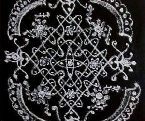 Rangoli: Chikku Kolam with 11-1 straight dots