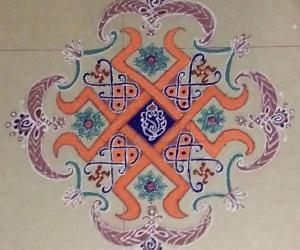 Rangoli: Dotted Ganesha Rangoli with colours 13×5 till 5 straight dots