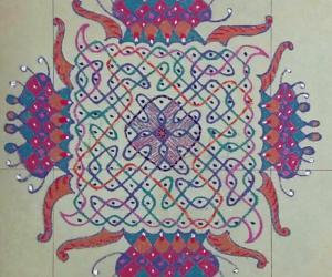 Rangoli: Chikku Kolam with 11-11 straight dots with freehand extension