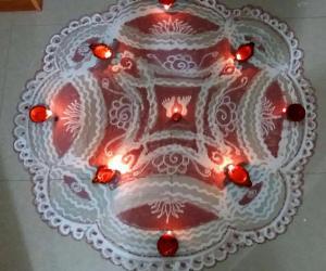 Rangoli: Krishnajayanthi Padi Kolam with rice batter
