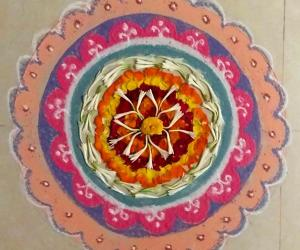 Rangoli: Pookolam # 011with freehand outer design with colours.
