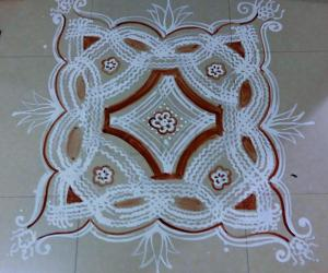 Navarathiri Iyengar Padi Kolam with rice batter