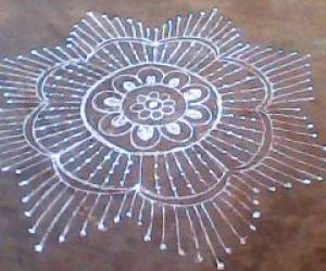 simple rangoli with dots and lines