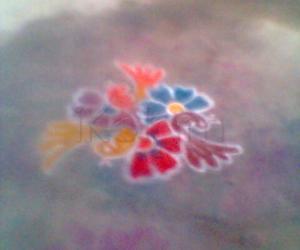 Rangoli: three cute birds on three bright flowers