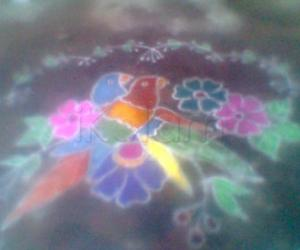 Rangoli: colourful birds and flowers