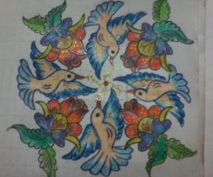 birds rangoli with flowers