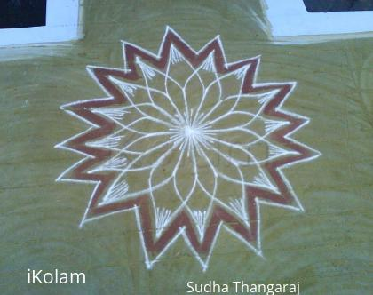 Rangoli: line kolam. by putting thin lines in the form of arc this kolam is finished.