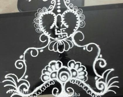 Rangoli: Kalas and swastik rangoli in white